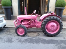 A pink tractor (street ad for a clothing brand)