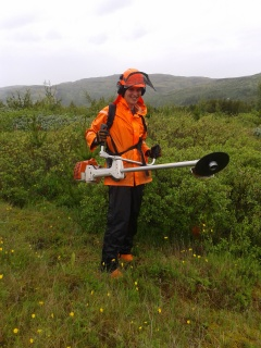 Posing with the brush cutter